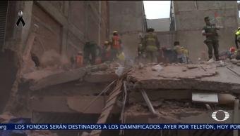 Rescatistas trabajan arduamente en edificio de Laredo y Ámsterdam