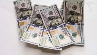 El dólar abre en 18.04 pesos a la venta