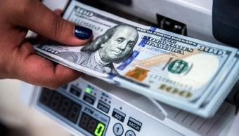 El dólar abre en 18-13 pesos en bancos