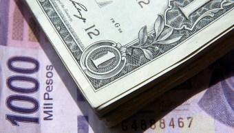 El dólar se vende en 18-14 pesos en bancos