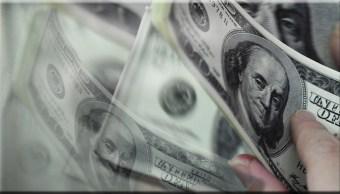 el dólar pierde en la apertura de la sesión