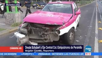Chofer de taxi huye tras chocar contra trolebus en Eje Central