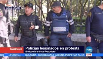 Cinco policías CDMX resultan lesionados por petardos durante manifestación en Reforma