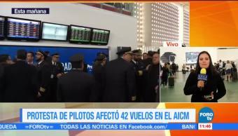 Protesta de pilotos contra jornada durante enfermedad afecta vuelos en el AICM