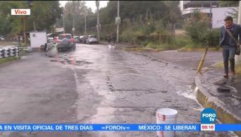 Fuga de agua en Picacho Ajusco y Periférico Sur