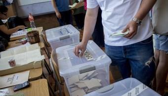 Chilenos votan pese a incidentes aislados en las elecciones presidenciales