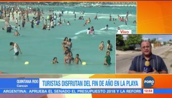 Turistas extranjeros disfrutan las playas de Quintana Roo este fin de año