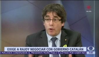 Puigdemont demanda a Rajoy negociar con autoridades de Cataluña