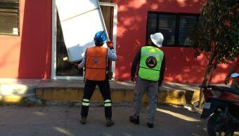 fuertes vientos provocan caída de postes y espectaculares en juchitan, oaxaca