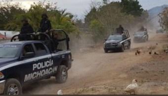 Hallan cinco cuerpos en un un auto abandonado en Michoacán