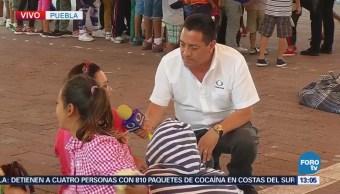 Dan atención médica a niños de caravana migrante en Puebla