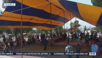 Migrantes permanecen en campamento en Puebla