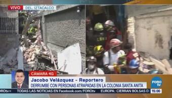 Esperan rescate de mujer atrapada entre escombros en Santa Anita
