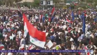 Sirios salen a las calles de Damasco para apoyar al Ejército