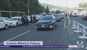Caos vial en autopista y carretera federal México-Toluca por transportistas