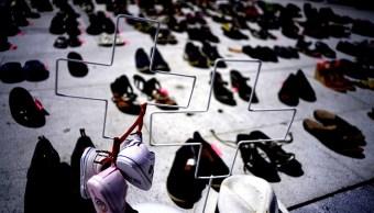 Colocan zapatos Capitolio Puerto Rico muertos María