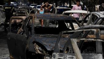Suman 50 muertos y 150 heridos por incendios en Grecia