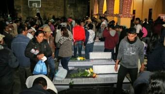 Sepultan comuneros asesinados Oaxaca por conflicto agrario
