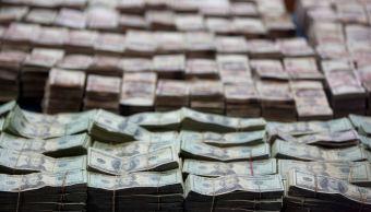 Peso mexicano cae por toma de utilidades, dólar a 18.91