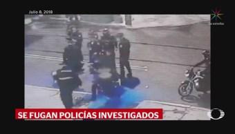 Se fugan policías investigados por golpear