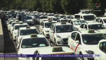 Taxistas de España mantienen huelga contra servicios privados