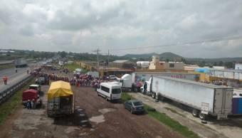 Camioneta arrolla a 7 peregrinos en la México-Querétaro