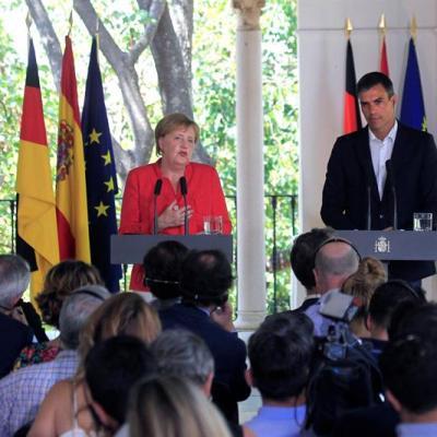 España y Alemania piden esfuerzo común en UE con inmigrantes