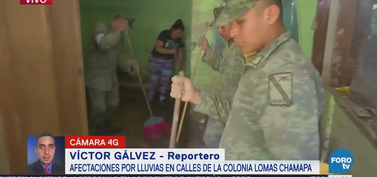 Militares auxilian a familia afectada por lluvias en Naucalpan