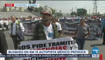 Bloquean km 31 autopista México-Pachuca, denuncian extorsion