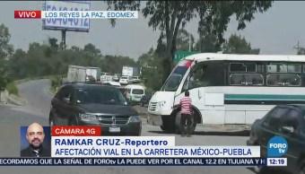 Siguen problemas viales en carretera México-Puebla bloqueo