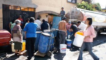 Negocios y policías hacen preparativos por corte de agua