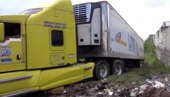 Avanza identificación de cuerpos encontrados en tráileres en Jalisco