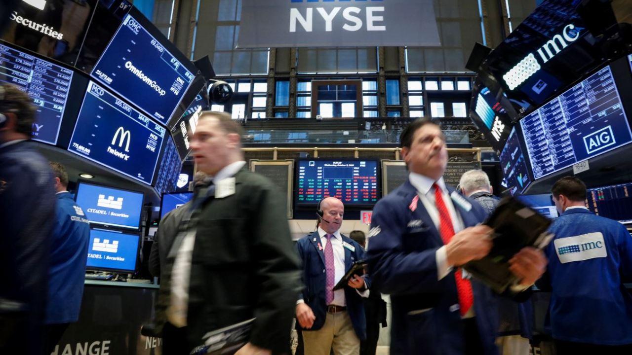 Wall Street amplía ganancias, Dow Jones cerca de récord