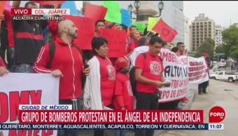 Bomberos protestan en el Ángel de la Independencia