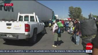 Migrantes bloquean la autopista México-Querétaro