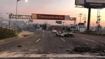 Bloqueo en la México Pachuca cumple siete horas; manifestantes queman patrulla