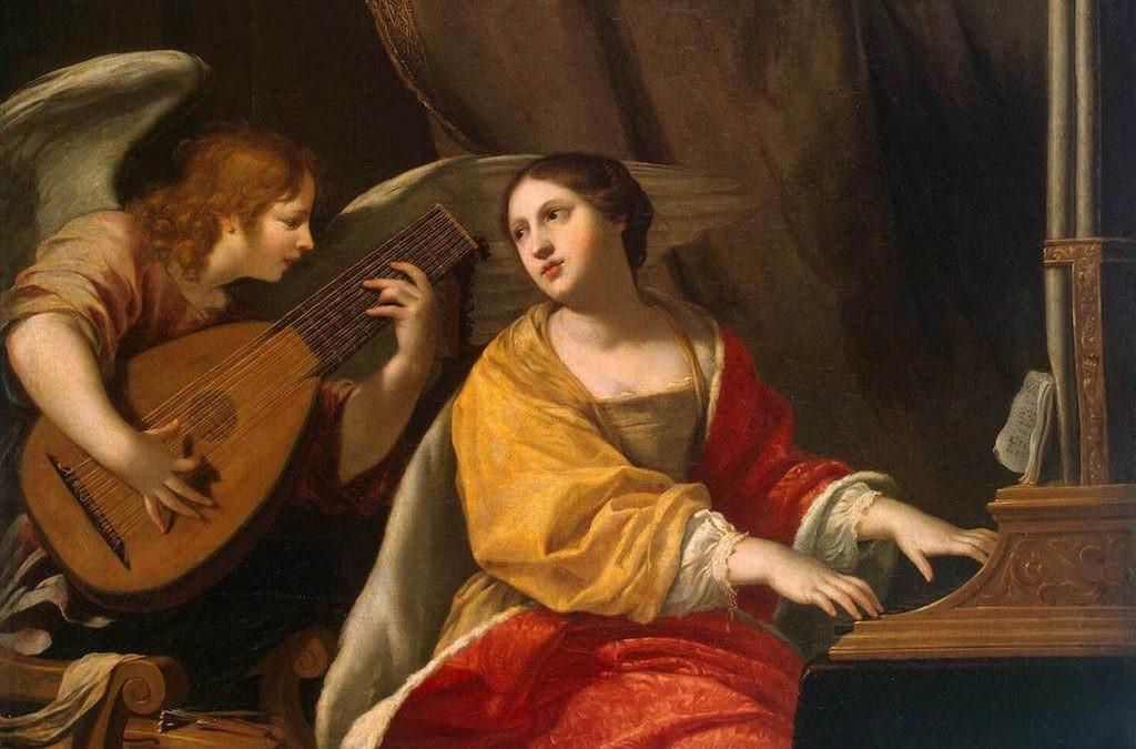 Santa Cecilia en una de sus representaciones más comunes, tocando un órgano y cantando (Zupnija)