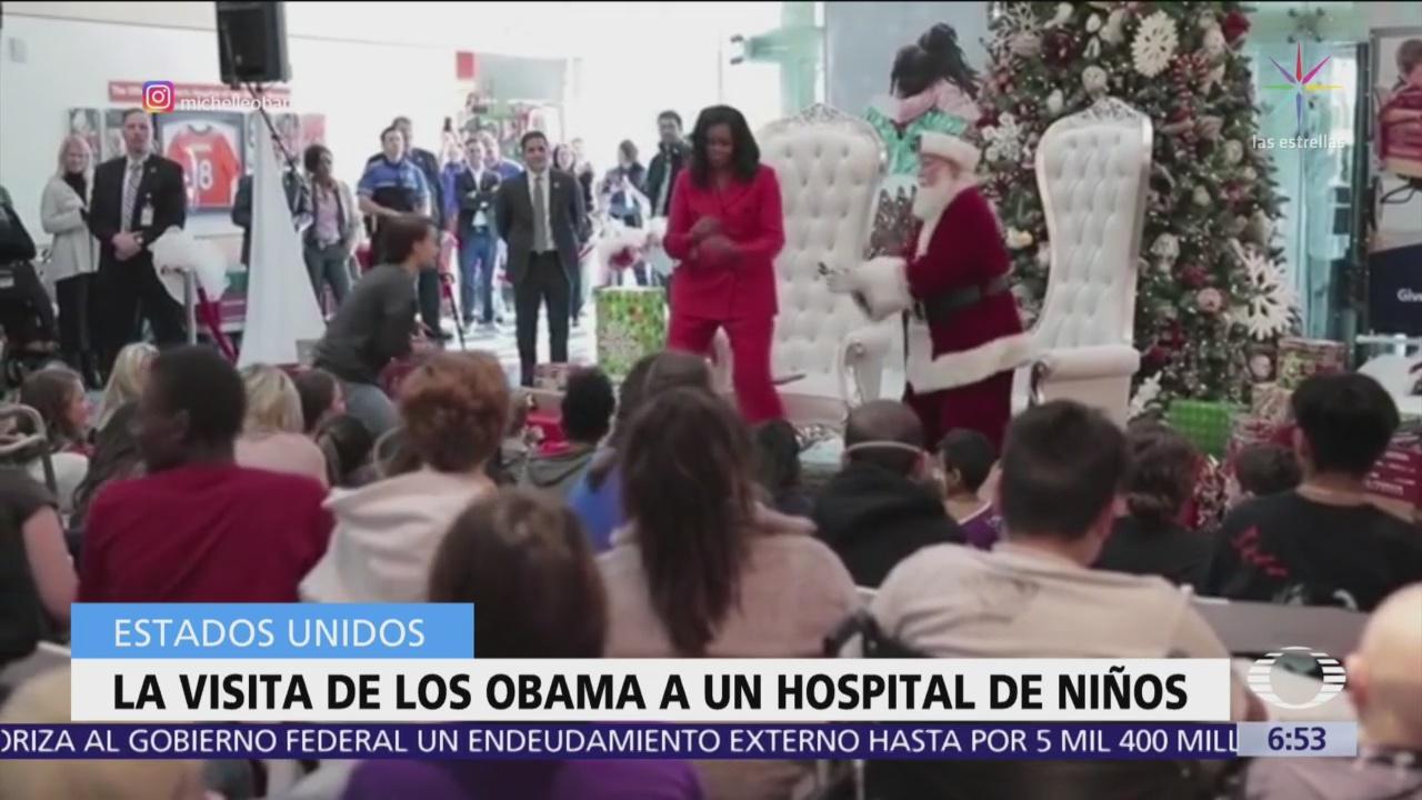 Barack y Michelle Obama visitan hospital y regalan juguetes