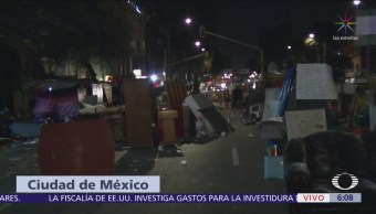 Continúa bloqueo en Arcos de Belén por desalojo de personas