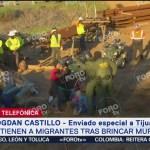 Detienen a migrantes tras cruzar muro fronterizo