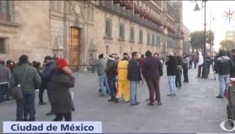 Trabajadores despedidos del SAT protestan Palacio Nacional