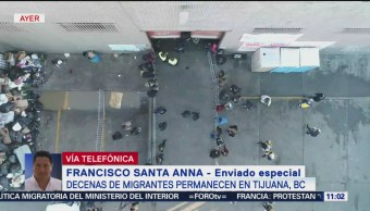 Buscan desalojar bodega ocupada por migrantes en Tijuana