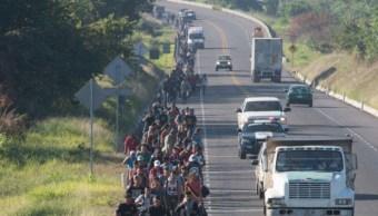 Migrantes rezagados en Chiapas avanzan a municipio de Oaxaca