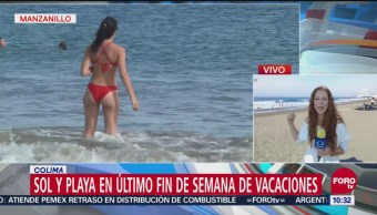 Turistas disfrutan del último fin de semana de vacaciones