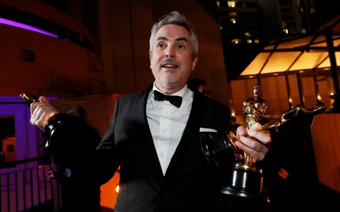 Foto: Alfonso Cuarón se llevó este domingo los Oscar a mejor dirección, mejor película extranjera y mejor fotografía, el 24 de febrero de 2019 (Reuters)