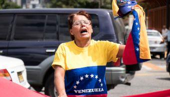 Foto: Una mujer venezolana protestas contra Nicolás Maduro en las calles de Caracas el 30 de enero del 2019