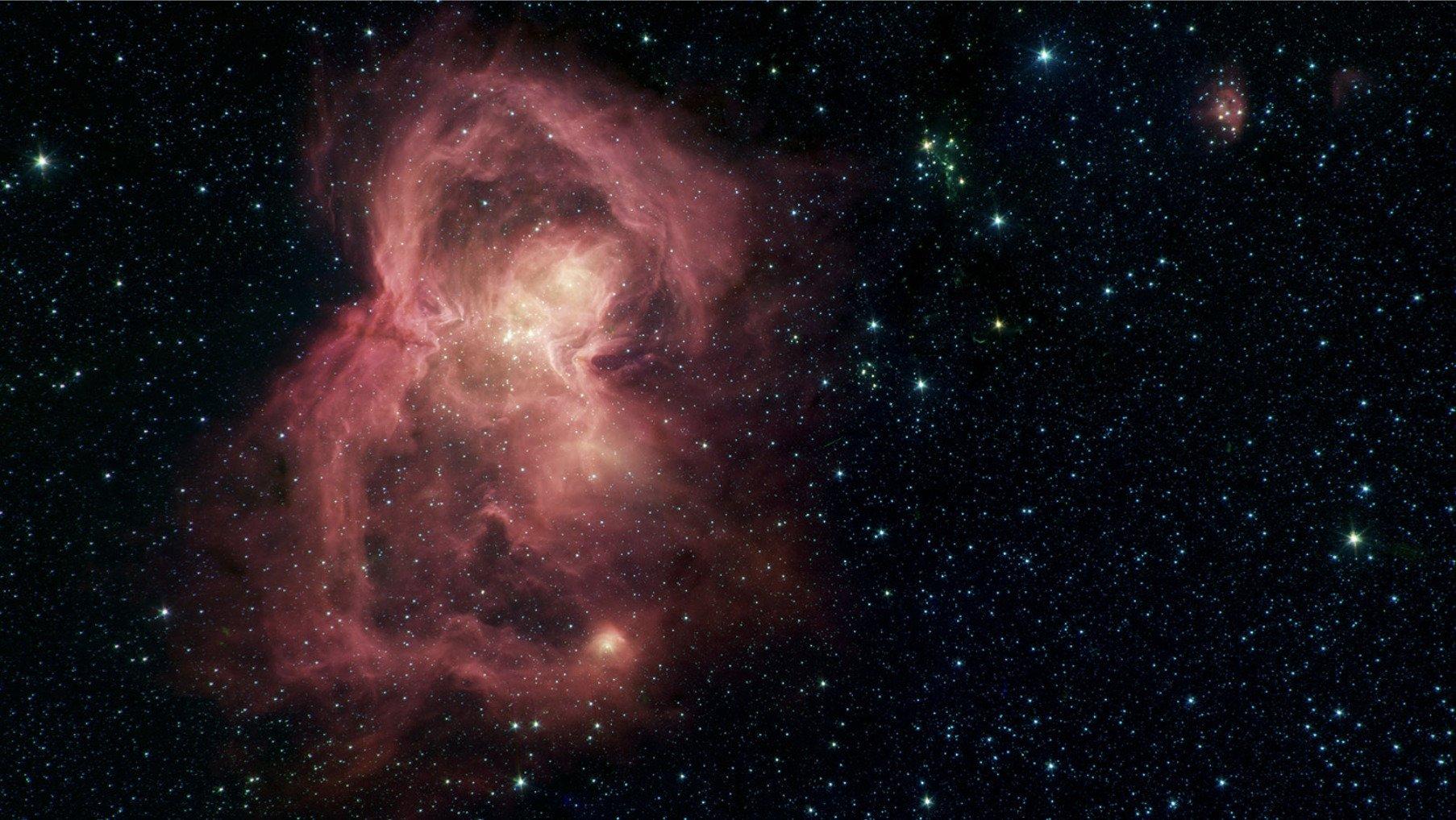 La imagen de la nebulosa W40 que parece una 'mariposa roja espacial' difundida por el Laboratorio de Propulsíón a Chorro de la NASA, ubicado en California (Twitter/@NASAspitzer)