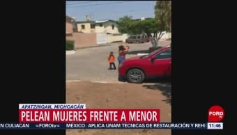 Pelean mujeres frente a niño en Apatzingán, Michoacán