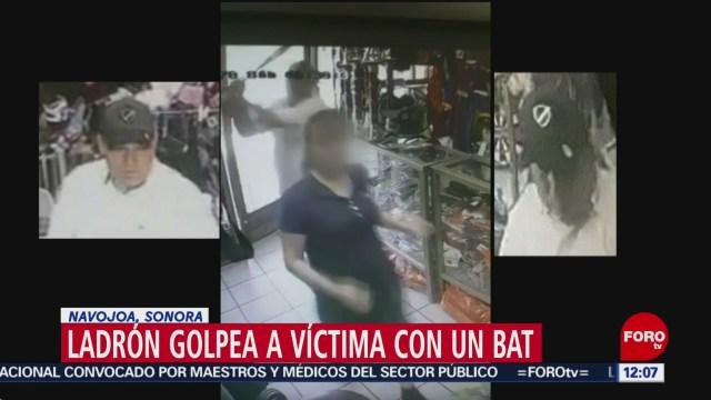 Asaltante golpea a mujer con bat para robar tienda