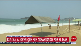 Buscan a joven arrastrado por mar de fondo en Puerto Escondido, Oaxaca